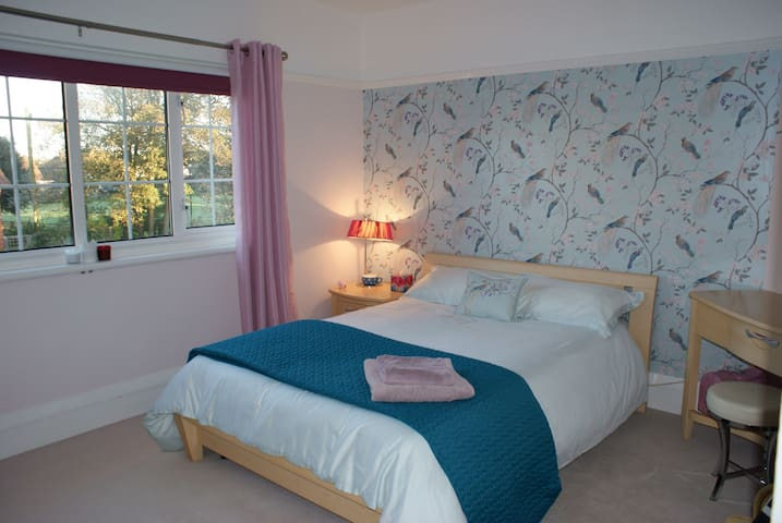Double bedroom with tea / coffee making facilities - facing west and overlooking the village green