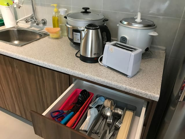 Our kitchen is equipped with basic kitchenware such as toaster,rice cooker,steamboat cooker,kettle,water purifier and other utensils.