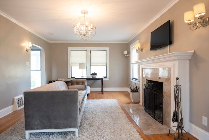 The living room and sunroom at Dunestead are perfect for a family gatherings. Full size operating fireplace, sofa and seating, and a sunroom off to the south.