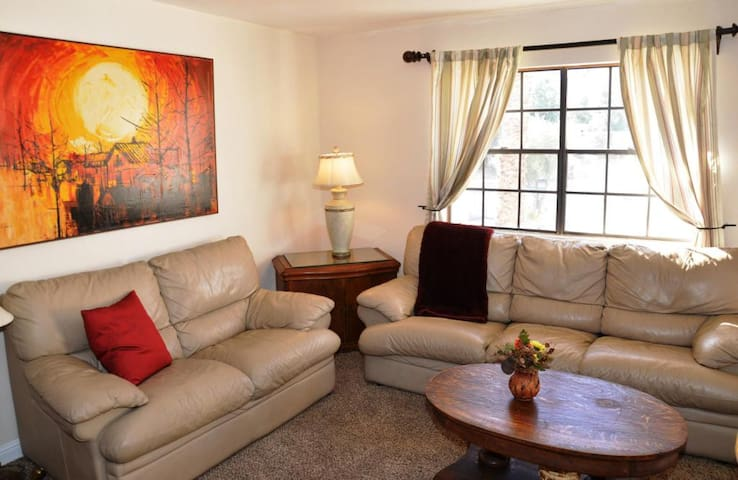 The living room has plenty of seating with large comfortable leather couch and love seat as well as 2 accent chairs