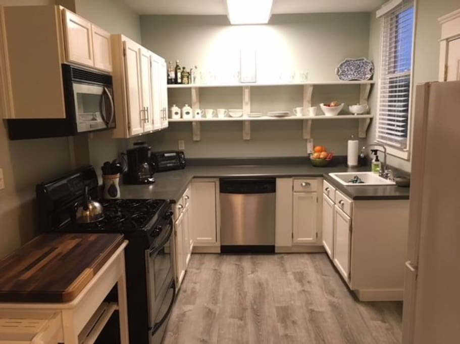 Fully equipped, stainless steel appliances including range, microwave, dishwasher, toaster oven, coffee maker and all utensils and place settings.  Full sized refrigerator.