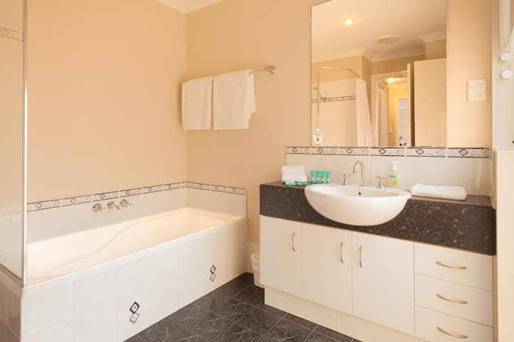 Bathroom with shower, bath and separate toilet