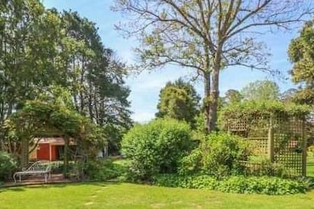 Peaceful rural retreat in one acre tranquil garden