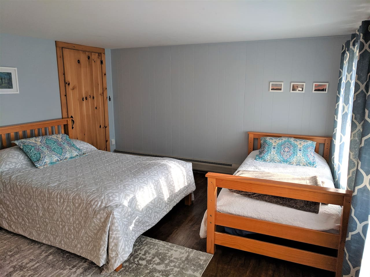 Bedroom with one full bed and one twin bed