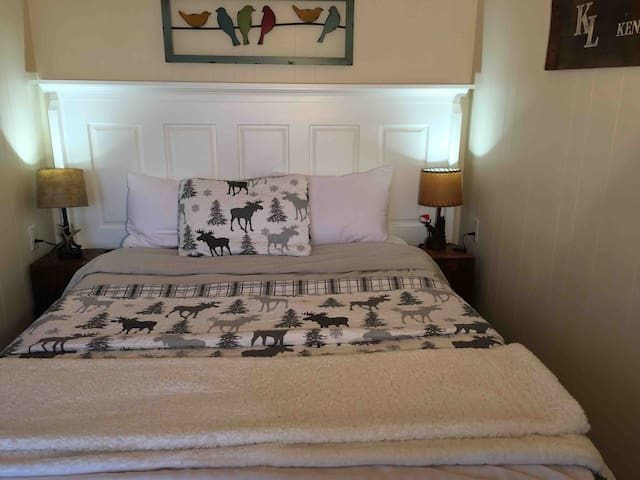 Bedroom with queen bed and walkout to your private deck.
