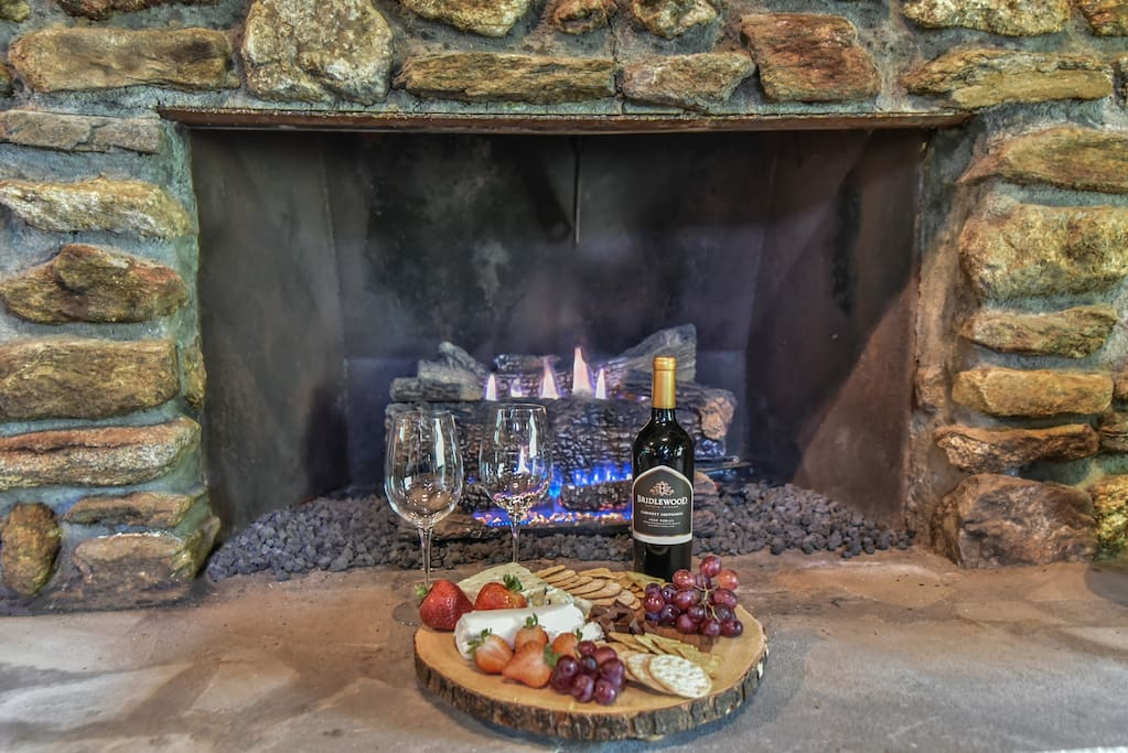 Stone gas fireplace for cool evenings in the mountains