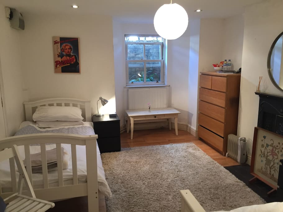 Large basement room with two single beds