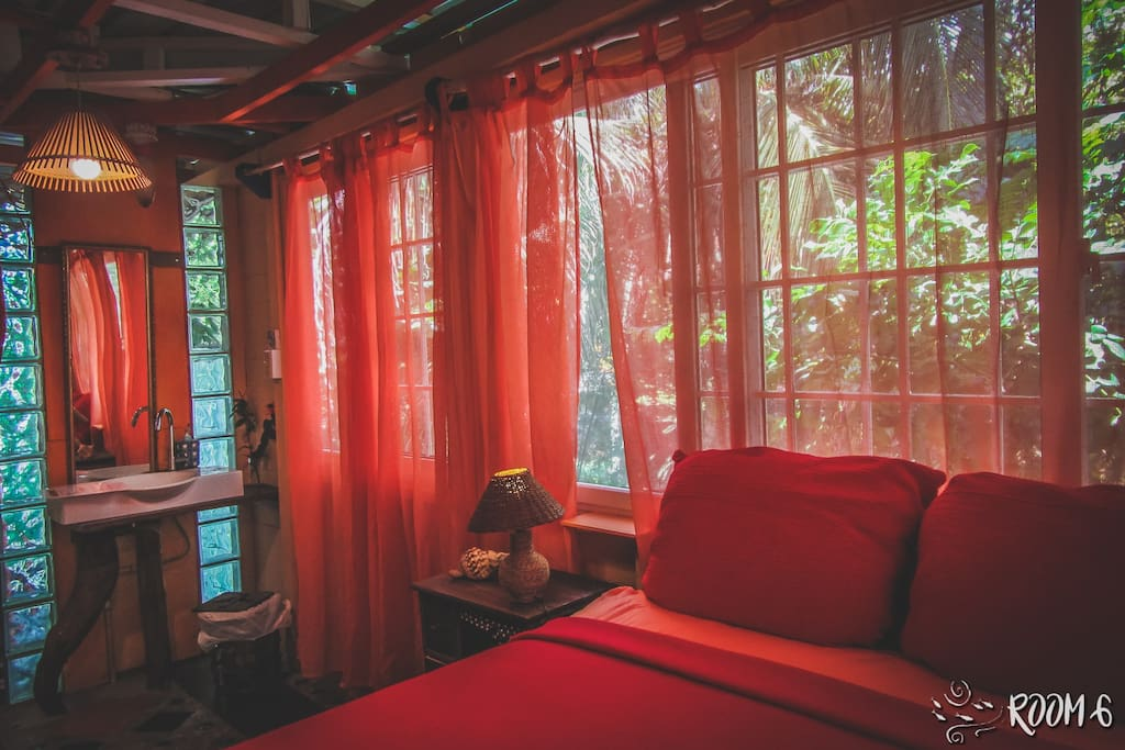 Bedroom surrounded by windows