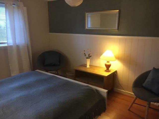 Bedroom1, sitting room & private entrance in Gjógv