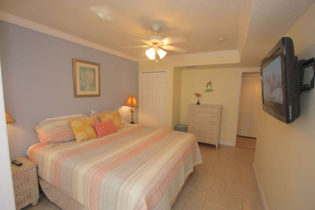 Unwind after a Long Beach or Exploring Day in this spacious Master Bedroom with Brand New King Bed and Flat Screen TV
