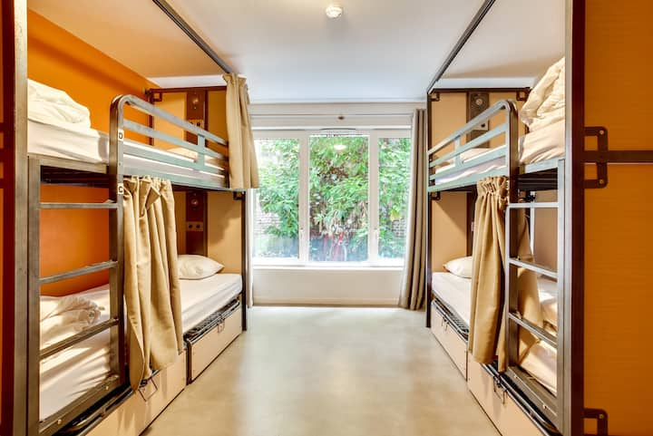 A bed in shared room with 4 travelers ensuite