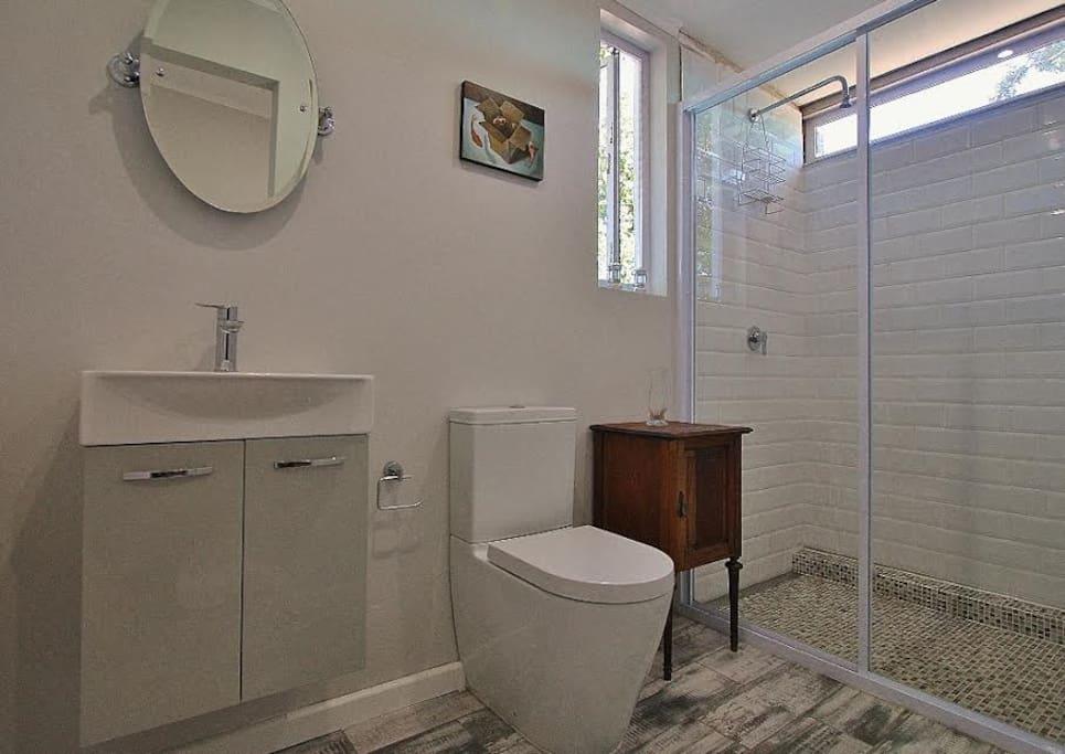 En suite bathroom with very spacious shower cubicle.