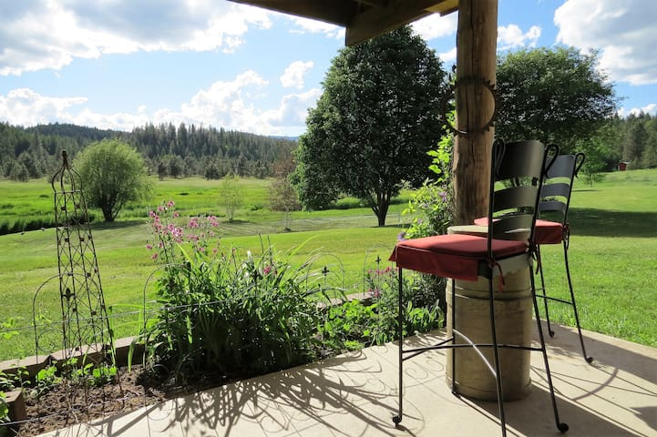 View from private covered patio with two, love seats and two high chairs.