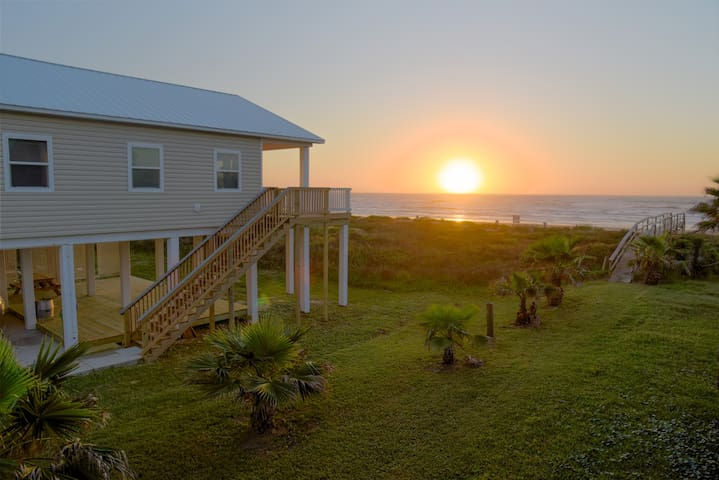 Enjoy the beautiful sunrise and beachfront view at Tranquility Base.
