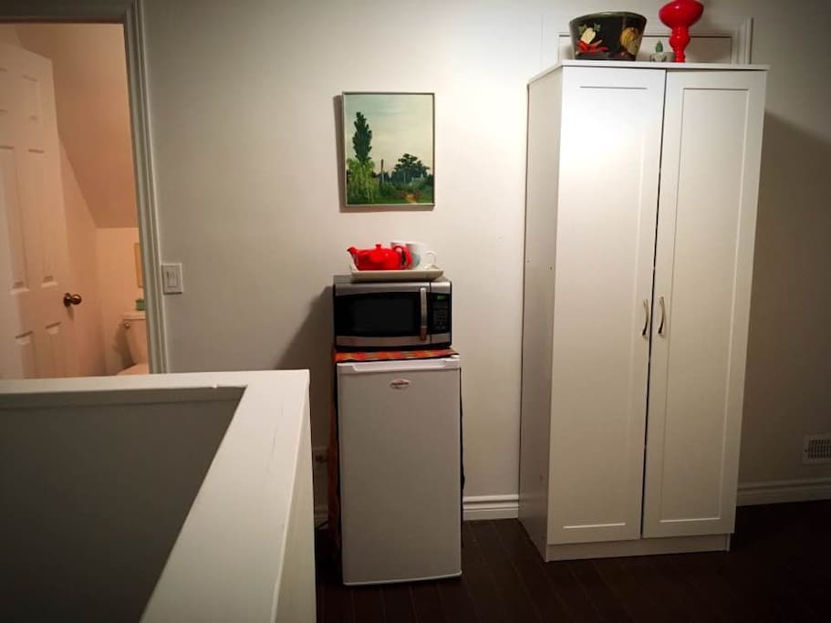 Fridge, microwave and pantry cupboard