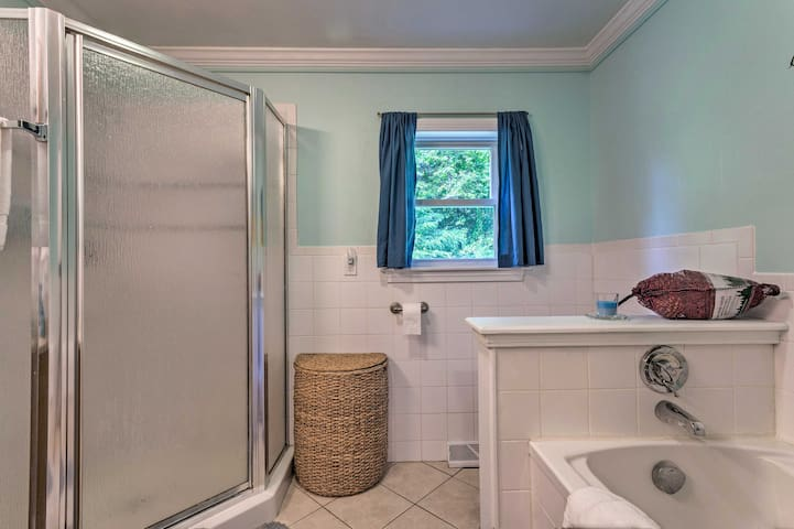 Soak in the tub or rinse off in the walk-in shower.
