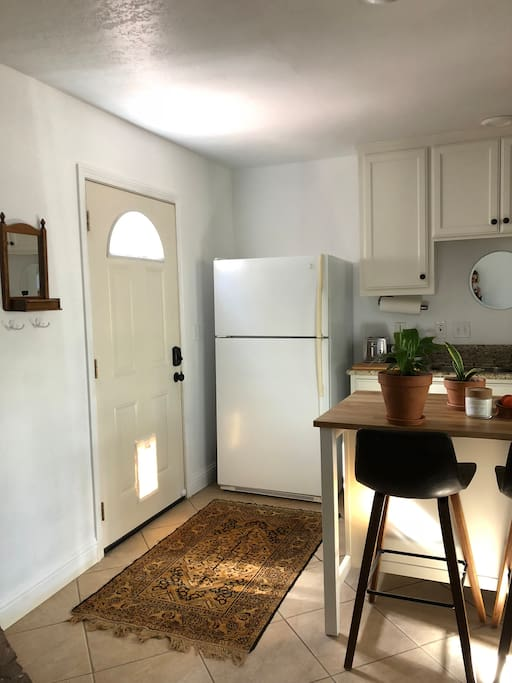 Kitchen / entry: Entry door to the left