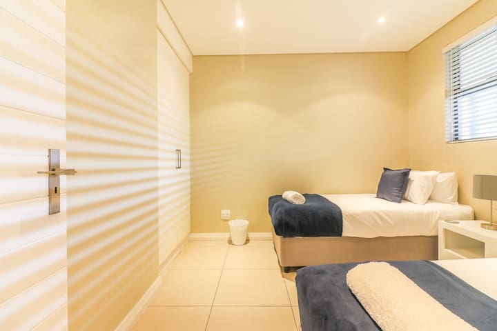 Bedroom 2- 2 Single beds ( can be made into Double bed if required)