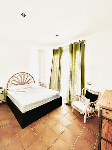 Bamboo Master Double Bedroom with exit to the Front Terrace.