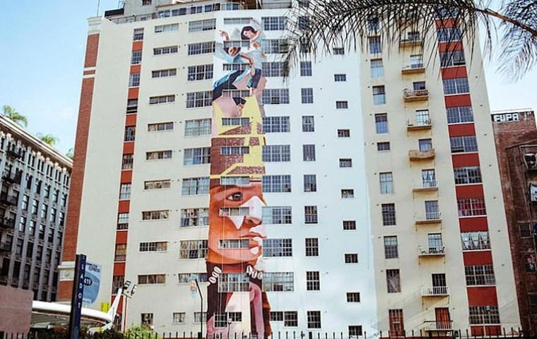 """Largest mural in the world painted by a single artist, """"Angelus,"""" being painted on side of our building"""