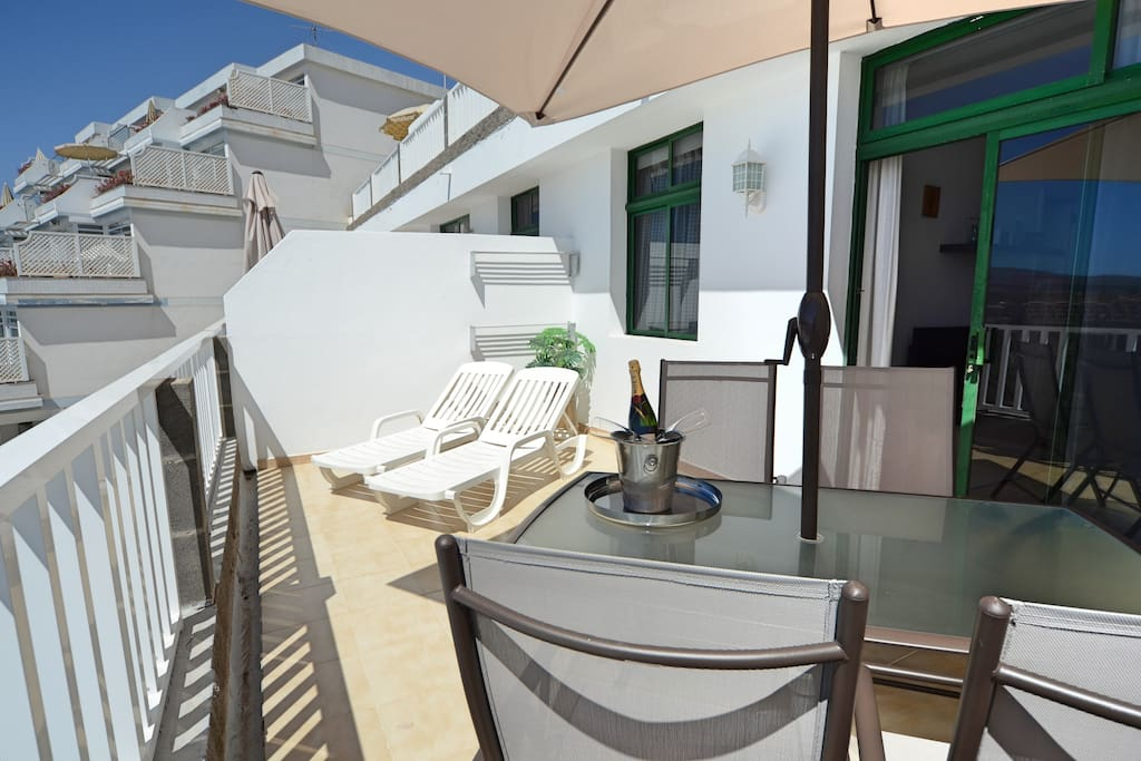 Spacious Private Terrace with Dining Table and Sunbeds