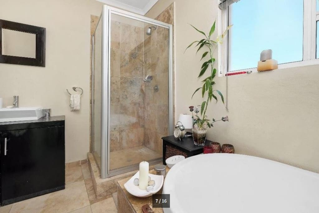 Full Bathroom with huge bath and full shower