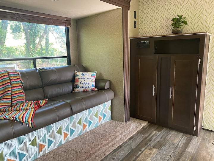Spacious camper with queen bed and full kitchen