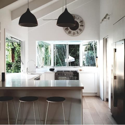 A chefs Kitchen. Spacious with beautiful ocean views and a gorgeous Caesarstone bench.