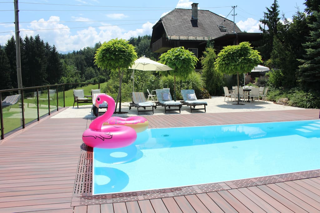 Heated salt water pool with lounge chairs and outdoor table. Pool stays open thru middle of September depending on weather conditions.