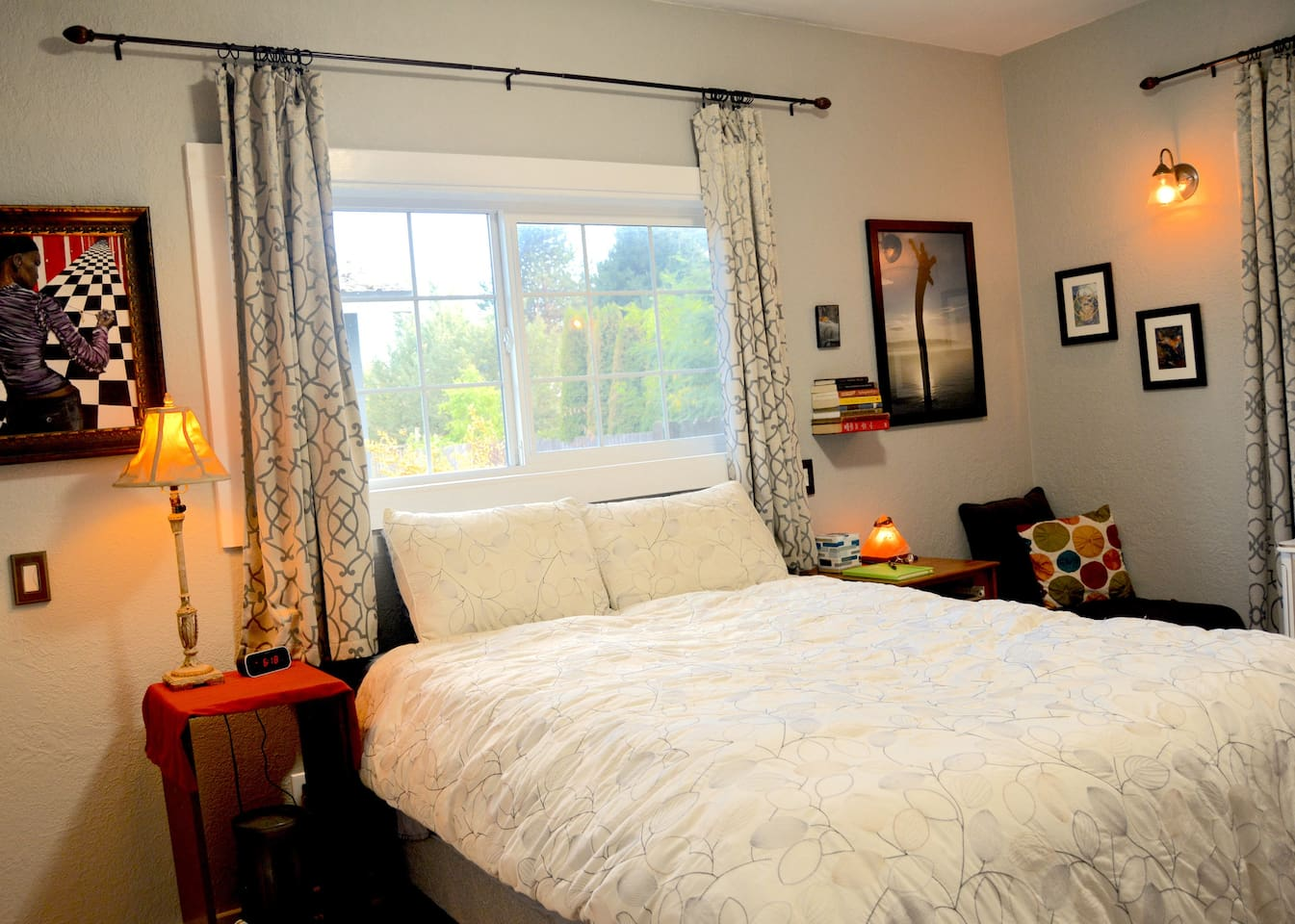 The room, with queen size soft bed and original artwork