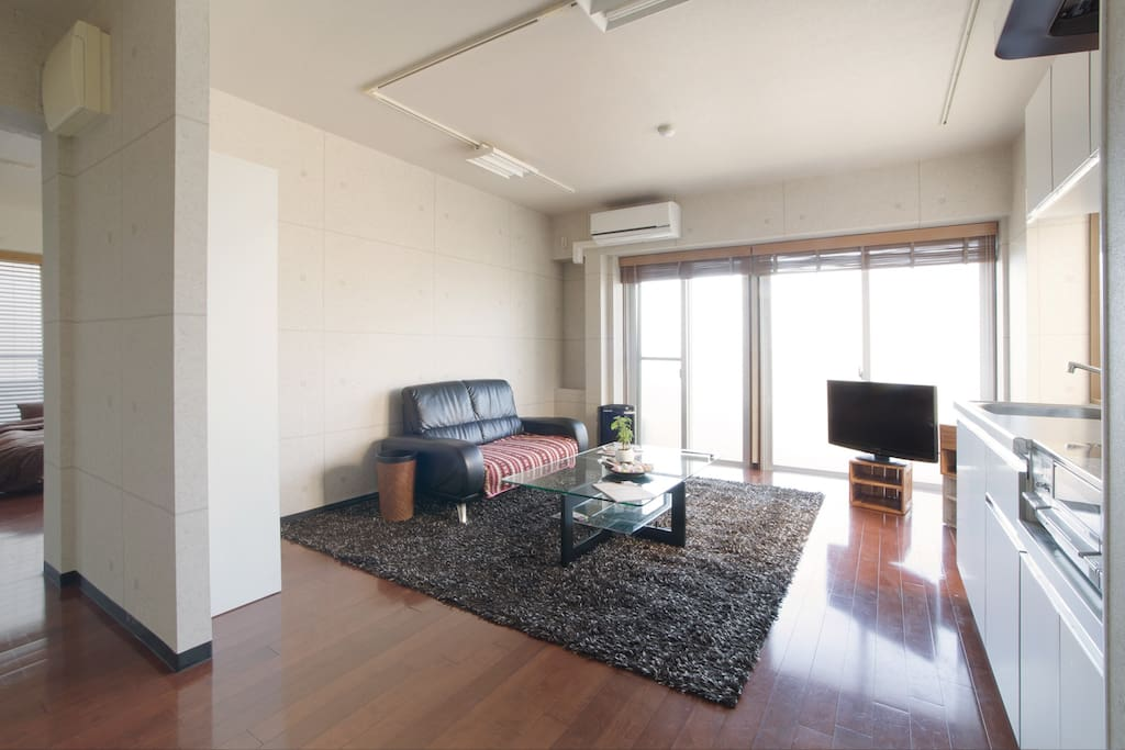 Bright living and dining area including television