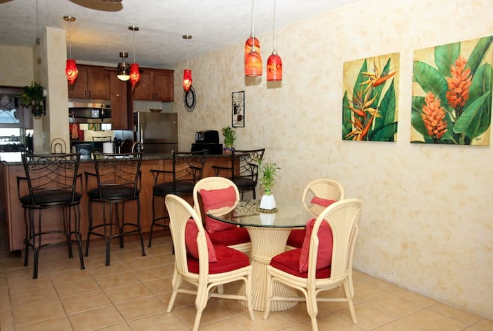 Indoor dining for four with additional barstool seating.