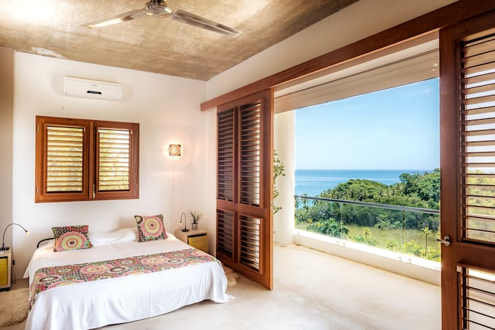 Guests bedroom. AC, ceiling fan, terrace and storm shutters