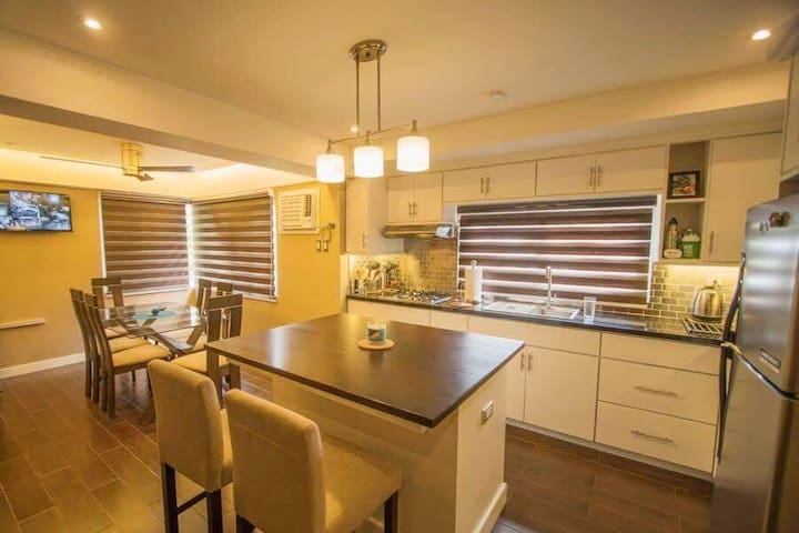 A modern condo type 2 bedroom home  with all the modern amenities i.e. Free Hi-Speed Wifi, Carbon Monoxide & Smoke Detectors, Cable TV,  Complete Kitchen, 3rd Floor Deck, Lounging and Entertainment Area on the ground floor.