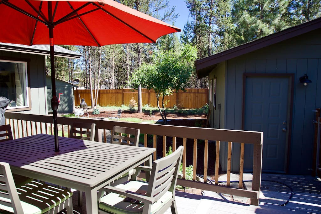 Enjoy some time in the serene yard, surrounded by pine trees and wildlife. Relax around the fire pit or at the patio table
