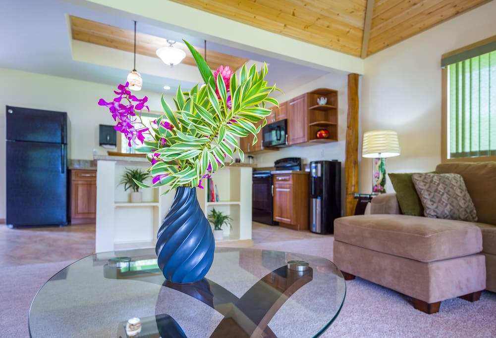 Relax in the living room with the kitchen directly adjacent.