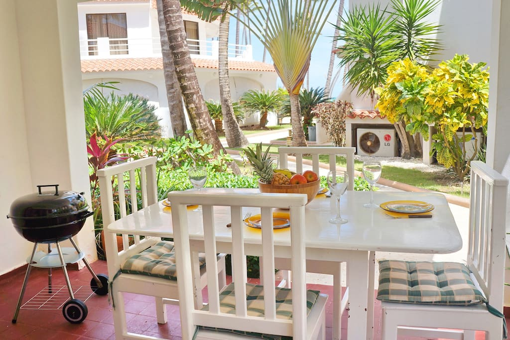 Outside dining area with partial beach view