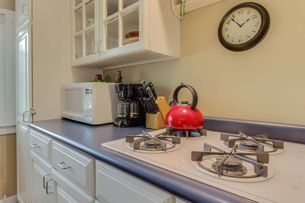 The kitchen has a gas range, but no oven.