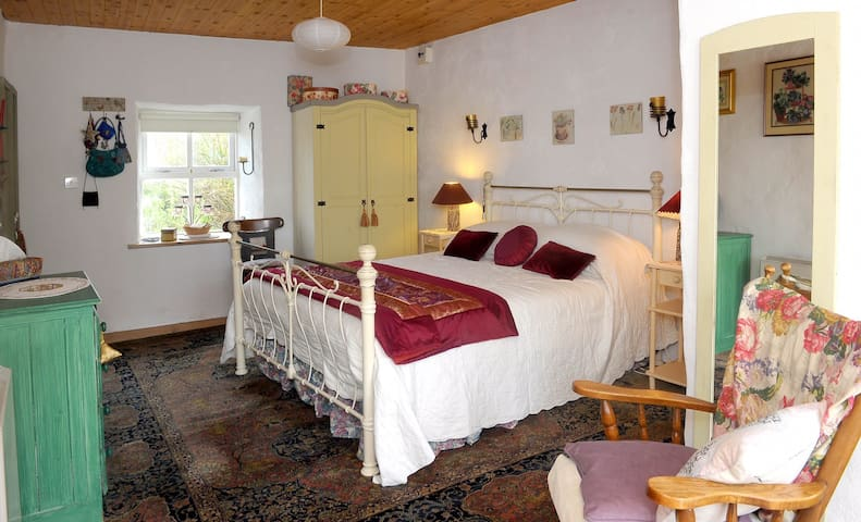 Lovely master bedroom with antique furnishings and window seat