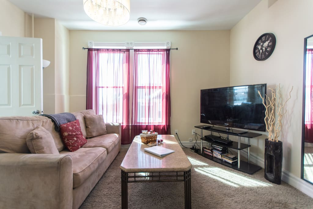 Large and bright living room with Queen pull out couch, fast wifi, cable tv, dvds, books, and games. A great gathering place for movie or game night!