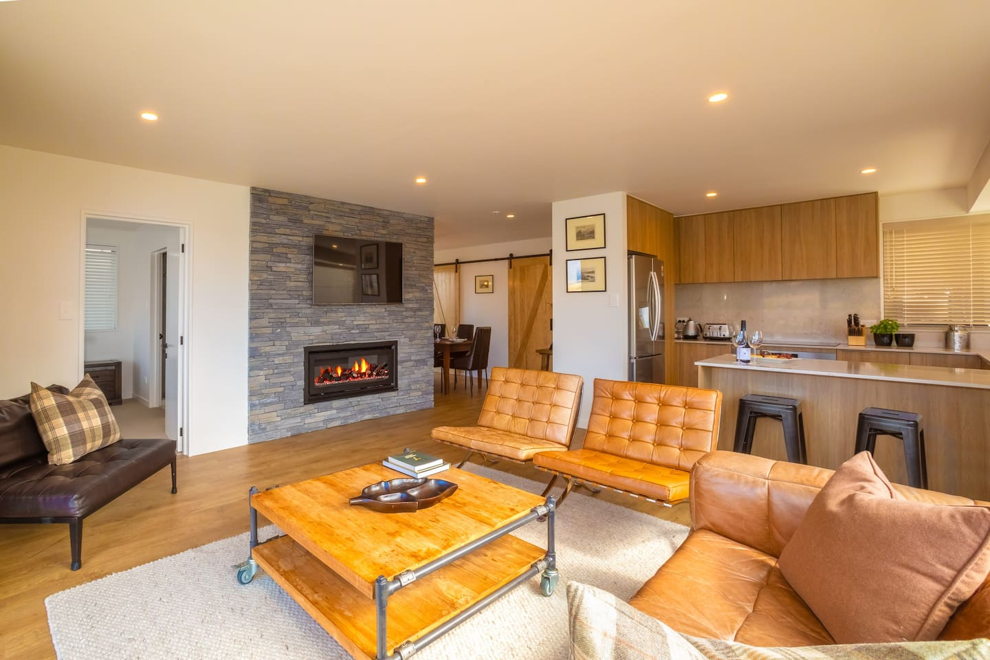 Upstairs Living Space with gas fire and luxury furnishings.  Enjoy the superb views over Lake Wakatipu and The Remarkables Mountain Ranges