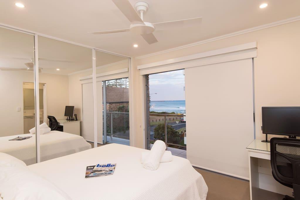 Main bedroom with ocean views and queen bed