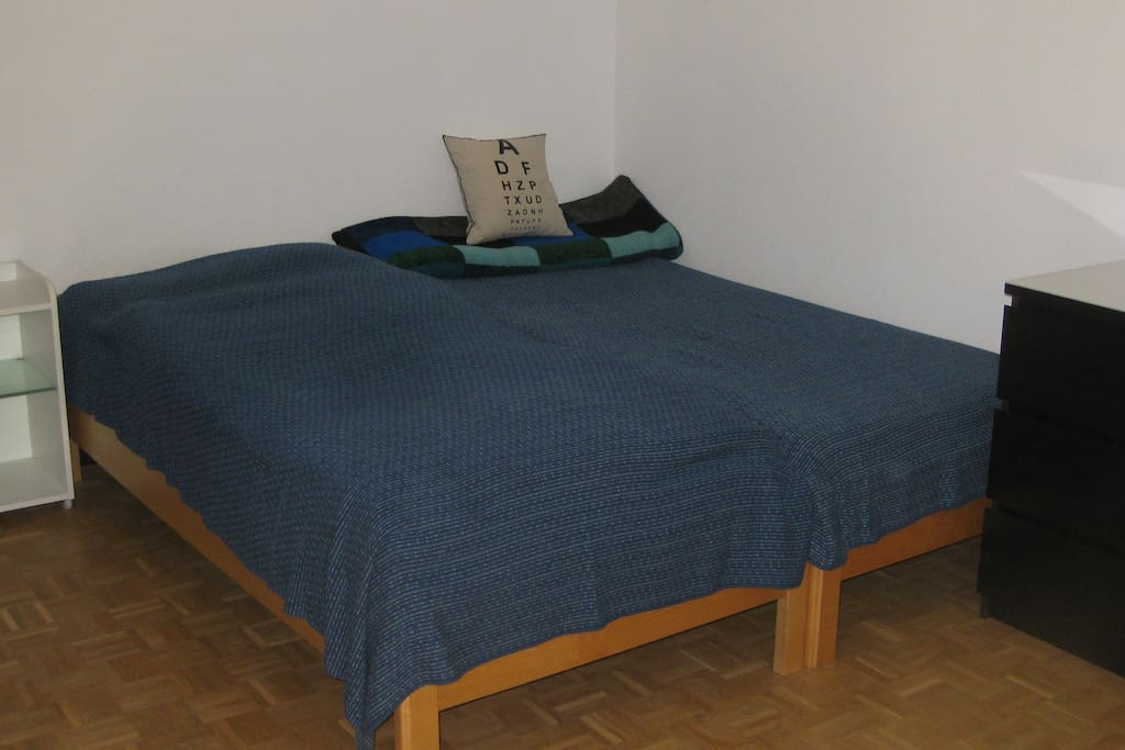 The Bed in the room gives you much space to enjoy sleeping.