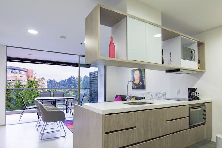 Spacious Condo with Pine Trees View. Near Airport