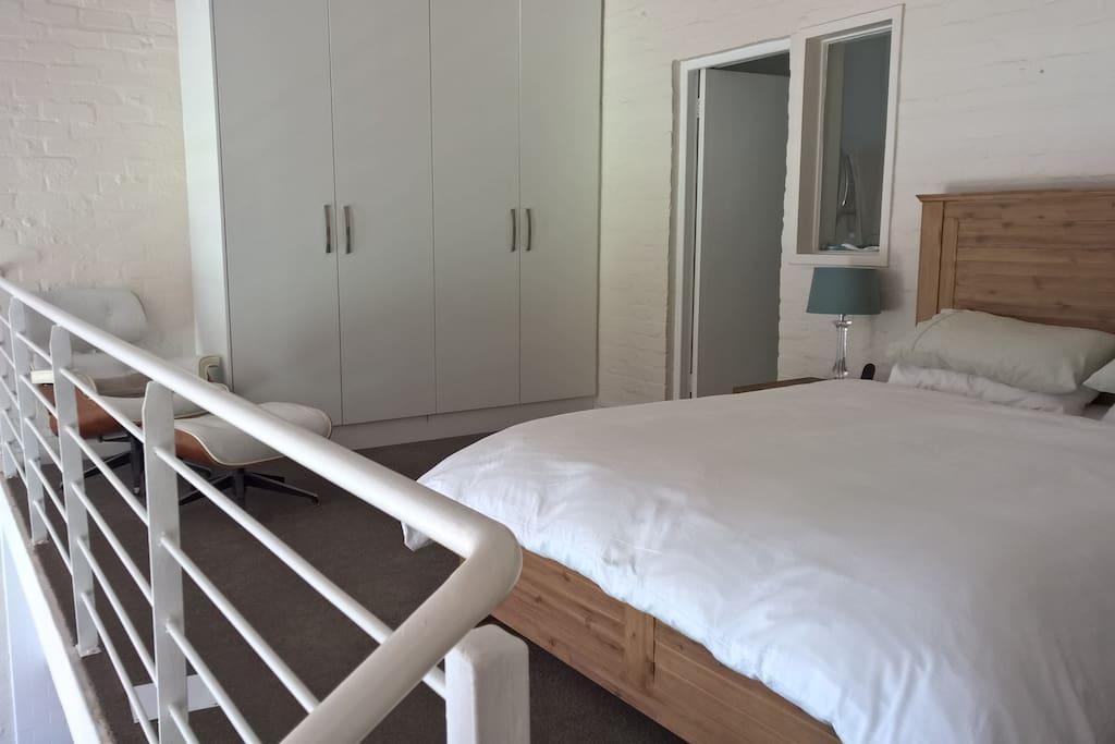 Cupboards, reading chair and big en-suite bathroom