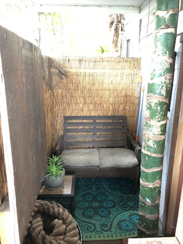 Your own private porch. Zen and Comfy. Chill Zone! 420 friendly and use this area to 420. No cigarettes in place or porch. Go outside to alley to smoke cigs (which is outside the door and gated entrance).