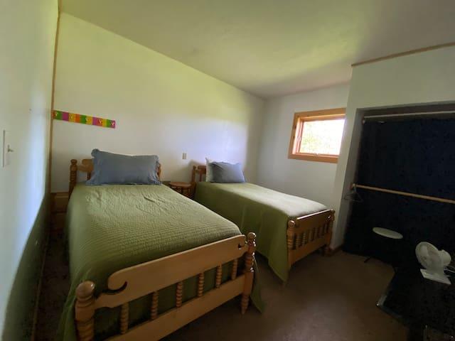 Bedroom located off garage