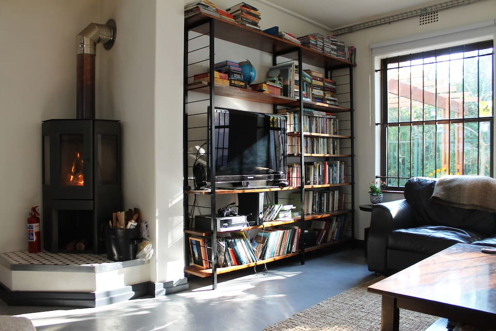 The living room, with lots of books and cozy fireplace for chilly winter evenings.