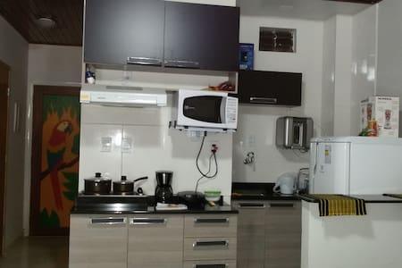 Flat com WiFi e linda vista para o Rio Negro - Centro - Apartment