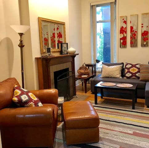Welcome to your private city duplex! Two adjoining 2-bedroom apartments with enough space for your entire family to enjoy. The home sleeps 12 people.  (pictured: top unit living room)